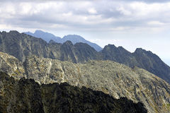 Ridge and peaks of high mountains Stock Image