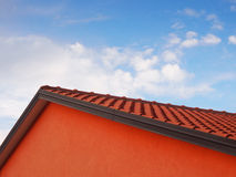 Ridge of the roof (2). With blue sky and clouds Royalty Free Stock Photography