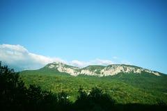 Ridge summer blue sky. Neyuo blue cloud mountain gorge hill forest park reserve clouds love puteschestviya green forest Royalty Free Stock Image