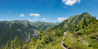 Ridge of summer mountains under blue sky Royalty Free Stock Images
