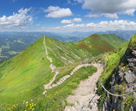 Ridge trail in the green summery Alps. From Fellhorn to Soellereck in the Allgau Alps, above the Kleinwalsertal and Oberstdorf on the border between Austria and Stock Photography