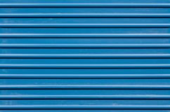 Ridged blue metal wall Stock Photography