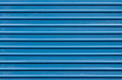 Ridged blue metal wall. Horizontal ridged blue painted metal wall texture Stock Photography