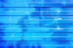 Ridged blue metal wall background texture. Ridged blue painted metal wall background texture Royalty Free Stock Photos