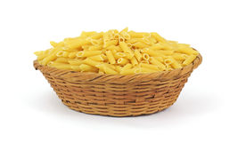 Ridged Hollow Pasta in a Basket. A basket full of diagonal cut thick round pasta Stock Image