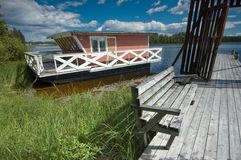 Ridged houseboat. Houseboat on Siljan lake in Sweden Royalty Free Stock Photography
