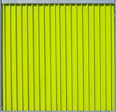 Ridged metal fence section taxture. Texture of bright green-yellow ridged metal fence section Royalty Free Stock Photography