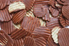 Ridged potato chips cover with Chocolate Stock Photo