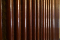 Ridged wooden surface. A closeup of a reddish-brown ridged wooden panel Stock Image