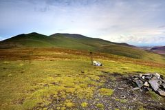 The ridgeline of Skiddaw. Rucksack and walking poles on Lonscale Fell Royalty Free Stock Image