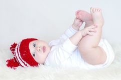 The ridiculous baby lies on back Stock Image