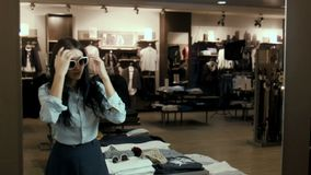 The ridiculous girl tries on sunglasses stock video