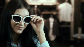 The ridiculous girl tries on sunglasses stock video footage