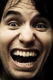Ridiculous screeming man Stock Photos