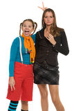 Ridiculous and serious girls, contrast Stock Photos