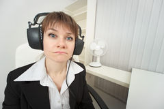 Ridiculous woman dressed on head big ear-phones Stock Image