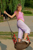 Riding девушки на качании Стоковое фото RF