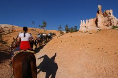 Riding. Horseback riding in canyons Royalty Free Stock Photo