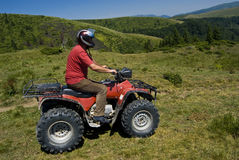 Riding atv - quad Royalty Free Stock Photography