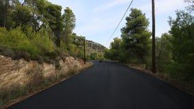 Riding ATV to serpantin roads of Poros island stock footage