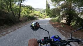 Riding ATV to serpantin roads of Poros island. stock video footage