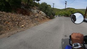 Riding ATV to serpantin roads of Poros island. stock video