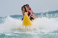 Riding banana boat Stock Photography