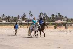 Riding on the beach. Horseback riding on the beach on the Atlantic Ocean in Gambia. Africa royalty free stock images