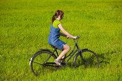 Riding a bicycle Stock Images