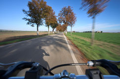 Riding a bicycle. Photo taken from a moving bicycle. Motion blur is used to give the impression of speed Royalty Free Stock Image