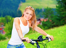 Riding on bicycle in Alpine mountains Stock Image