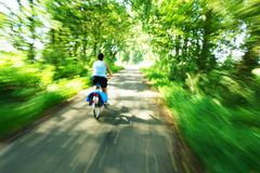 Riding a bicycle Stock Photography