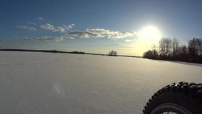 Riding bicycle on frozen lake stock footage