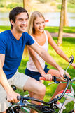 Riding bicycle is fun! Stock Photos
