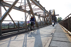 Riding bicycle on Long Bien bridge Stock Images