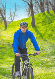 Riding bicycle. Riding mountain bicycle in the park with helmet, during spring Stock Photo