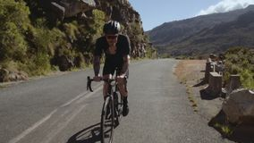 Riding a bicycle on mountain road stock video footage