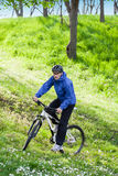 Riding bicycle. In the mountain, during spring Royalty Free Stock Photo