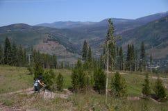 Riding on bicycle near Vail Colorado Royalty Free Stock Image