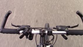 Riding bicycle with no hands stock video footage