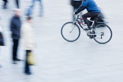 Riding bicycle in the pedestrian area Stock Photo