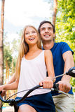 Riding bicycle together. Stock Photography