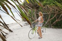 Riding bicycle on the tropical island Royalty Free Stock Photos