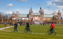 Riding Bicycles in Amsterdam royalty free stock photos