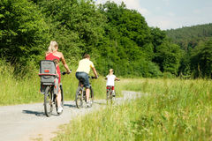 Riding the bicycles together Royalty Free Stock Images