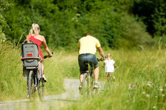 Riding the bicycles together royalty free stock image
