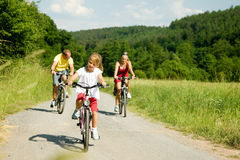 Riding the bicycles together Royalty Free Stock Photos