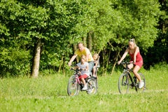 Riding the bicycles together Royalty Free Stock Photo