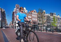 Riding a bike in Amsterdam royalty free stock photo