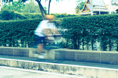 Riding a bike on bicycle lane , blurred motion Stock Images
